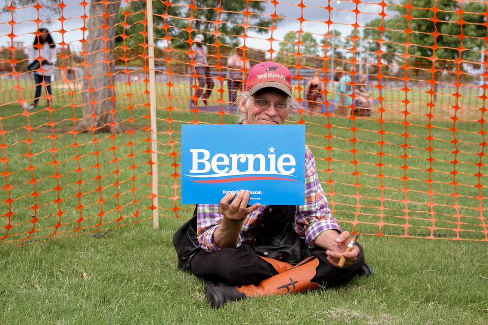 Photo - Joe Bush, sits at the Bernie Sanders rally at Reaves Park in Norman, Oklahoma Sept. 22, 2019. Bush drove three hours from Osage County to attend the event. [Paxson Haws/The Oklahoman]