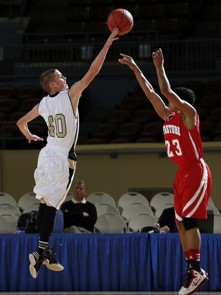 Photo - Moyers' Jake Dudley (40) blocks the shot of Big Pasture's Taran Knox (23) during a Class B Boys first-round game of the state high school basketball tournament between Moyers and Big Pasture  at Jim Norick Arena, The Big House, on State Fair Park in Oklahoma City, Thursday, Feb. 28, 2013. Big Pasture won, 66-64. Photo by Nate Billings, The Oklahoman