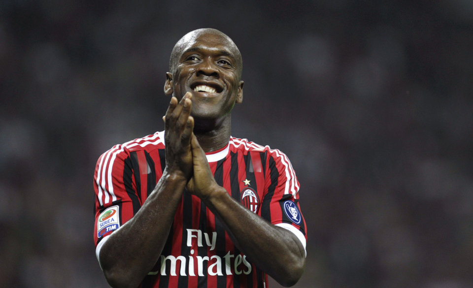 Photo - In this Saturday, May 14, 2011 photo AC Milan midfielder Clarence Seedorf, of the Netherlands, smiles during a Serie A soccer match between AC Milan and Cagliari at the San Siro stadium in Milan, Italy.  Clarence Seedorf said Tuesday, Jan. 14, 2014 he will take over as the new coach at AC Milan, replacing Massimiliano Allegri who was fired the day before. Seedorf made the announcement at Brazilian club Botafogo, where he has been playing.