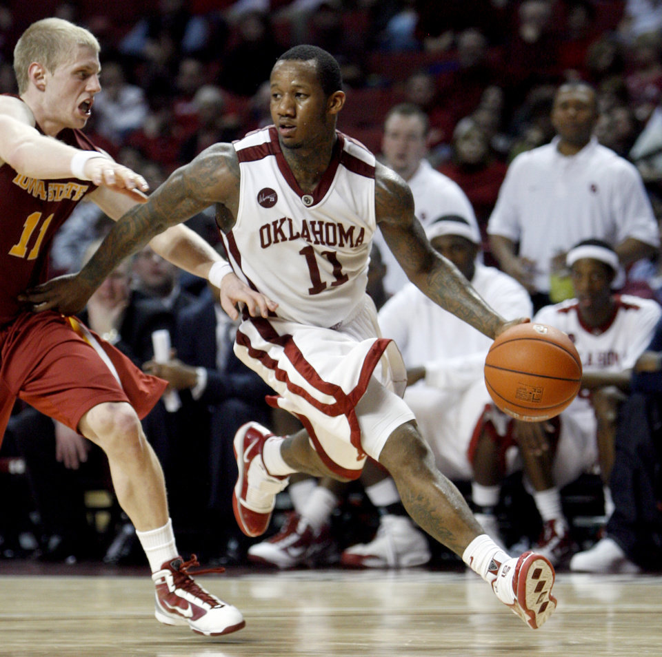 Photo - OU's Tommy Mason-Griffin (11) drives to the basket as Iowa State's Scott Christopherson (11) defends him during the men's college basketball game between the University of Oklahoma and Iowa State, Wednesday, Jan. 27, 2010, at the Lloyd Noble Center in Norman, Okla. Photo by Sarah Phipps, The Oklahoman.  ORG XMIT: KOD