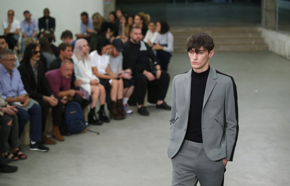 Photo - A models wears a creation by French fashion designer Guillaume Henry for Carven's men's Spring-Summer 2015 fashion collection presented in Paris, France, Wednesday, June 25, 2014. (AP Photo/Michel Euler)
