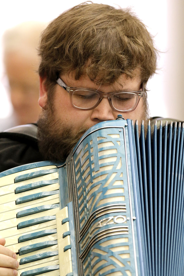 Photo -  Myke Dixo plays at the monthly meeting of the Oklahoma City Accordion Club. Photo by Doug Hoke, The Oklahoman   DOUG HOKE