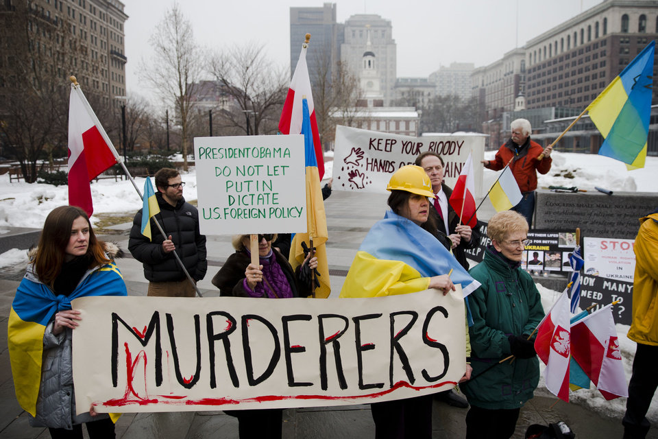 Photo - Members of the Ukrainian American and Polish American communities demonstrate in support Ukrainian anti-government protesters outside Independence Hall, Wednesday, Feb. 19, 2014, in Philadelphia. The violence on Tuesday was the worst in nearly three months of anti-government protests that have paralyzed Ukraine's capital, Kiev, in a struggle over the identity of a nation divided in loyalties between Russia and the West, and the worst in the country's post-Soviet history. (AP Photo/Matt Rourke)
