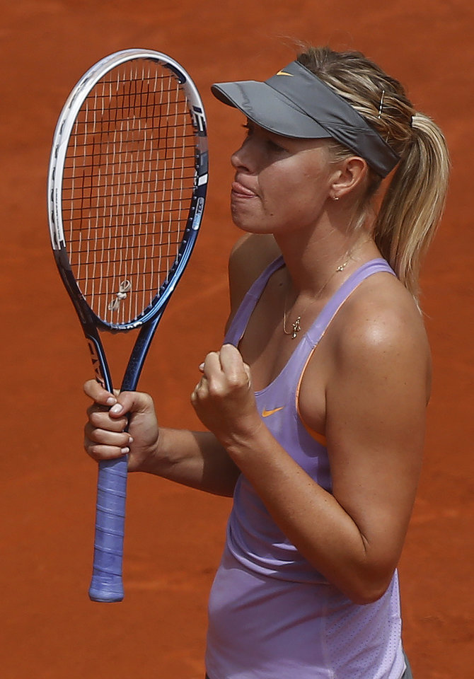 Photo - Maria Sharapova from Russia celebrates her victory against Christina McHale from US during a Madrid Open tennis tournament match in Madrid, Spain, Tuesday May 6, 2014. (AP Photo/Andres Kudacki)