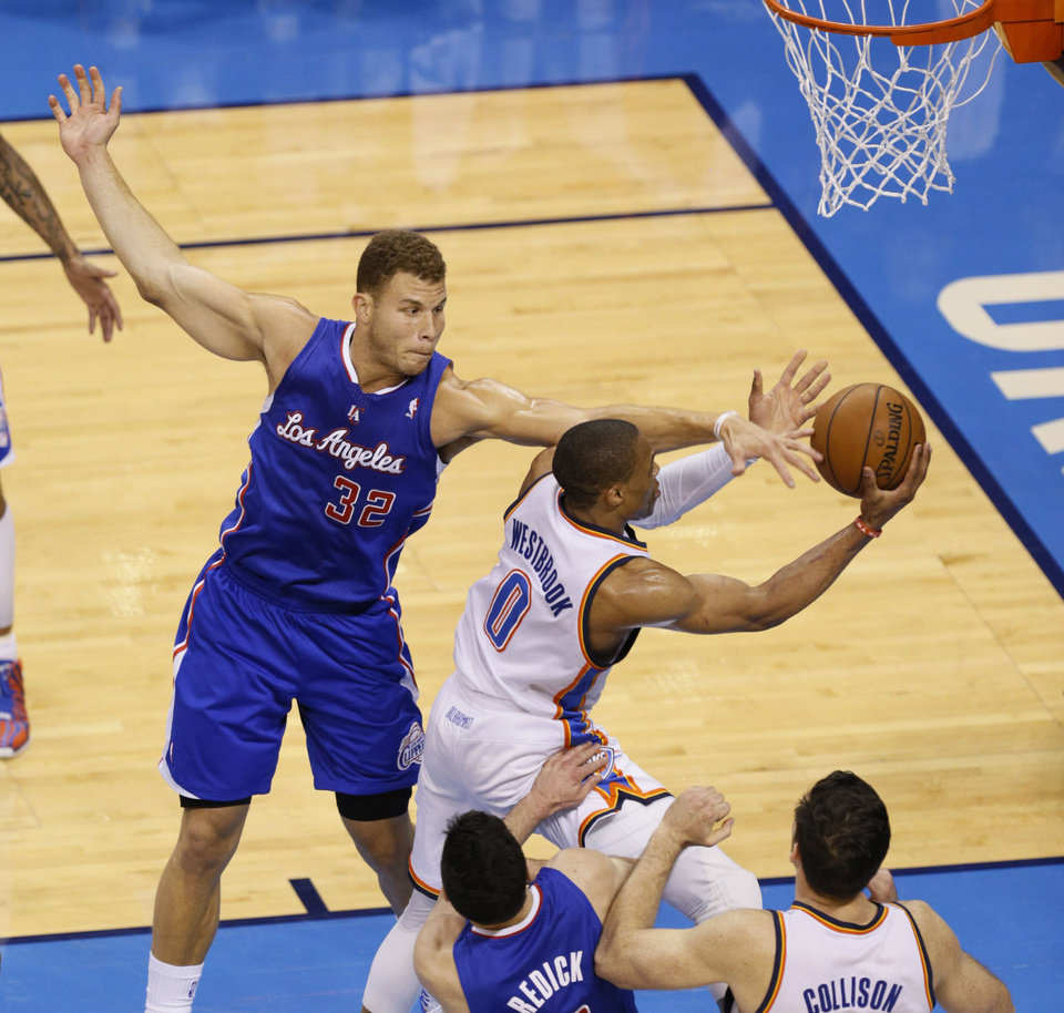 Photo - Blake Griffin (32) defends against Russell Westbrook (0) as he goes by J.J. Reddick (4) during Game 5 of the Western Conference semifinals in the NBA playoffs between the Oklahoma City Thunder and the Los Angeles Clippers at Chesapeake Energy Arena in Oklahoma City,  Tuesday, May 13, 2014. Photo by Bryan Terry, The Oklahoman