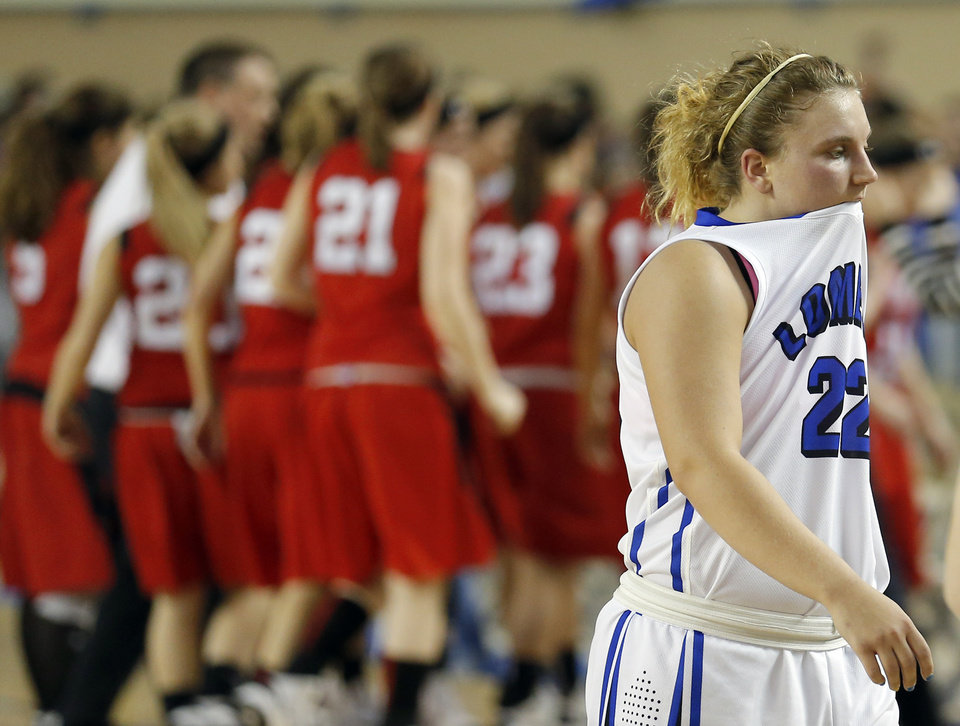 Photo - Lomega's Ashley LeGasse rects after Erick tied the game in the final seconds of regulation during the Class B girls state championship between Erick and Lomega at the State Fair Arena., Saturday, March 2, 2013. Photo by Sarah Phipps, The Oklahoman