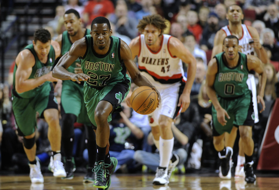 Photo - Boston Celtics' Jordan Crawford (27) runs against Portland Trail Blazers after a steal during the first half of an NBA basketball game in Portland, Ore., Saturday, Jan. 11, 2014. (AP Photo/Greg Wahl-Stephens)