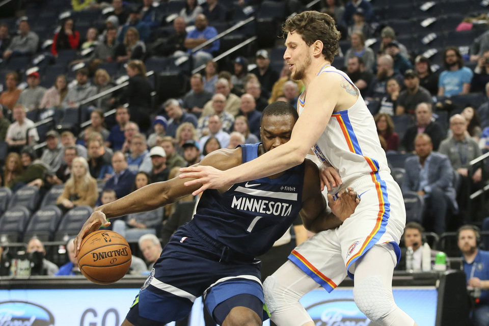 Photo - Minnesota Timberwolves' Noah Vonleh, left, runs into Oklahoma City Thunder's Mike Muscala in the first half of an NBA basketball game Monday, Jan. 13, 2020, in Minneapolis. (AP Photo/Jim Mone)
