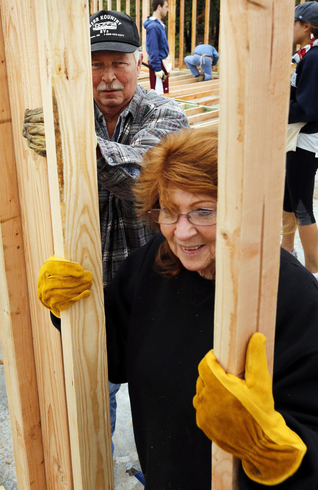 Photo - Joel and Bettie Spears lend a hand to volunteers as the frame work for their new house goes up in Bethel Acres. PHOTO BY STEVE SISNEY, THE OKLAHOMAN  STEVE SISNEY