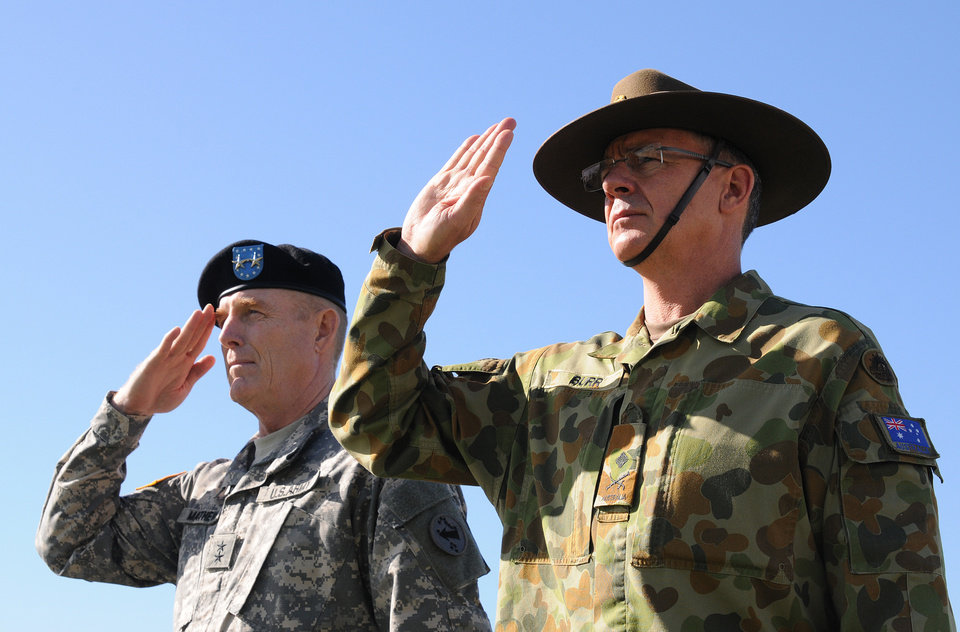 Photo - In this Jan. 17, 2013 photo provided by U.S. Army Pacific, U.S. Army Maj. Gen. Roger Mathews, left, and Australian Defence Forces Maj. Gen. Richard Burr salutes during a ceremony welcoming Burr to Fort Shafter, Hawaii. Burr's unprecedented appointment to be deputy commanding general at U.S. Army Pacific is the first time a non-American has served in such a high-ranking position at a command like this.  The move  symbolizes the Army's push to connect more with allies and friendly nations in the Pacific as the Obama administration rebalances national defense strategy toward the region.(AP Photo/U.S. Army Pacific, Angela Kershner)