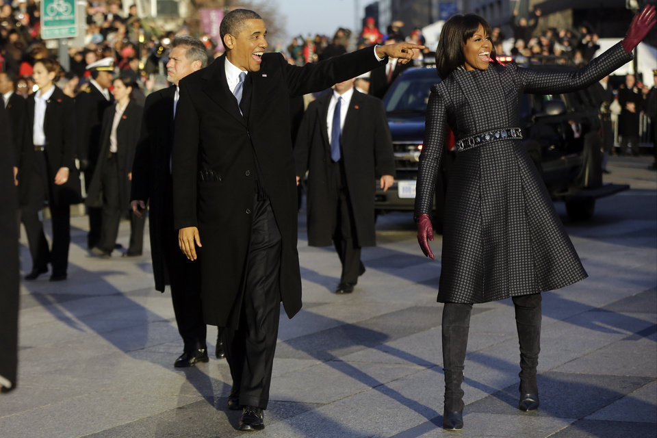 President Barack Obama and first lady Michelle Obama walk in the Inaugural Parade during the 57th Presidential Inauguration in Washington, Monday, Jan. 21, 2013. (AP Photo/Charles Dharapak) ORG XMIT: WHCD110