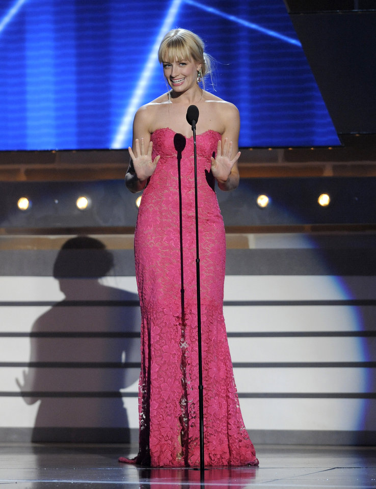 Actress Beth Behrs speaks on stage at the 48th Annual Academy of Country Music Awards at the MGM Grand Garden Arena in Las Vegas on Sunday, April 7, 2013. (Photo by Chris Pizzello/Invision/AP) ORG XMIT: NVPM237