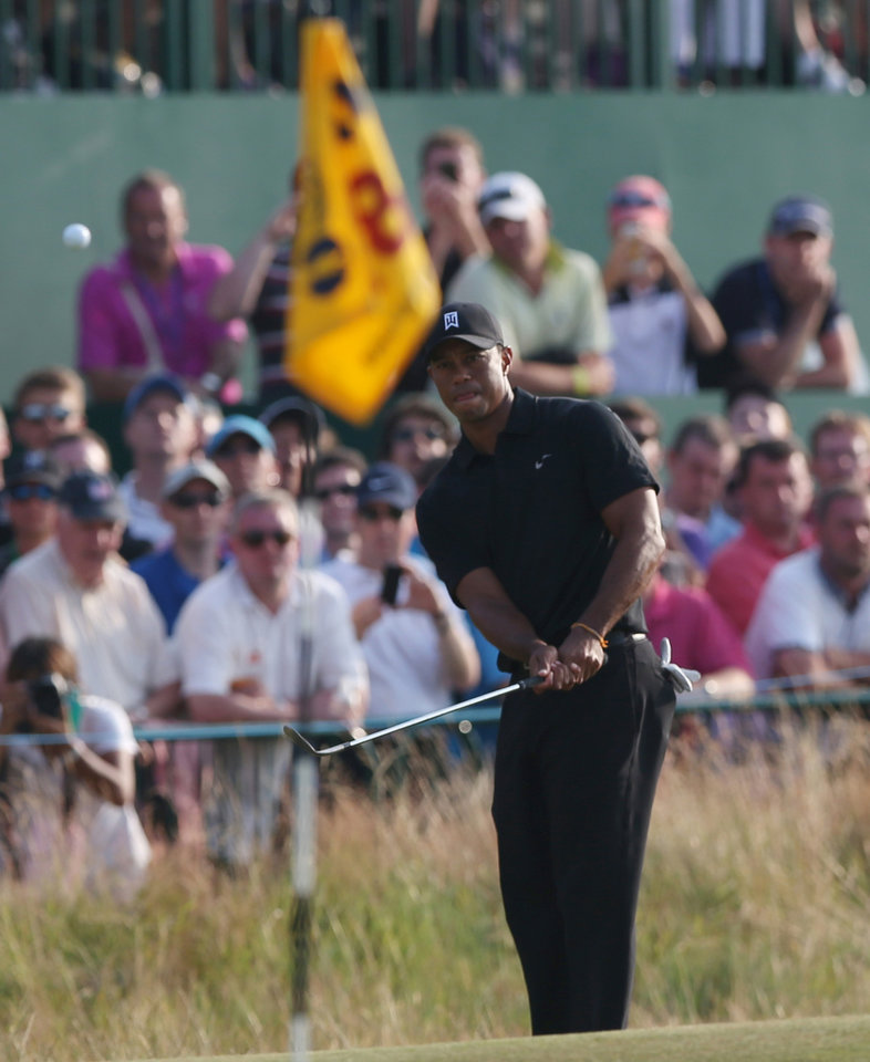 Photo - Tiger Woods of the US chips a shot onto the 18th green during the second day of the British Open Golf championship at the Royal Liverpool golf club, Hoylake, England, Friday July 18, 2014. (AP Photo/Jon Super)