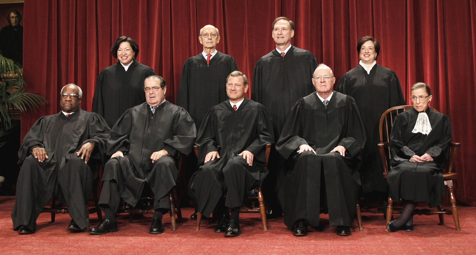 FILE - This Oct. 8, 2010 file photo shows the justices of the U.S. Supreme Court at the Supreme Court in Washington. Seated from left are Associate Justices Clarence Thomas, and Antonin Scalia, Chief Justice John Roberts, Associate Justices Anthony M. Kennedy and Ruth Bader Ginsburg. Standing, from left are Associate Justices Sonia Sotomayor, Stephen Breyer, Samuel Alito Jr., and Elena Kagan. The Supreme Court on Thursday, June 28, 2012, upheld the individual insurance requirement at the heart of President Barack Obama\'s historic health care overhaul. (AP Photo/Pablo Martinez Monsivais, File)