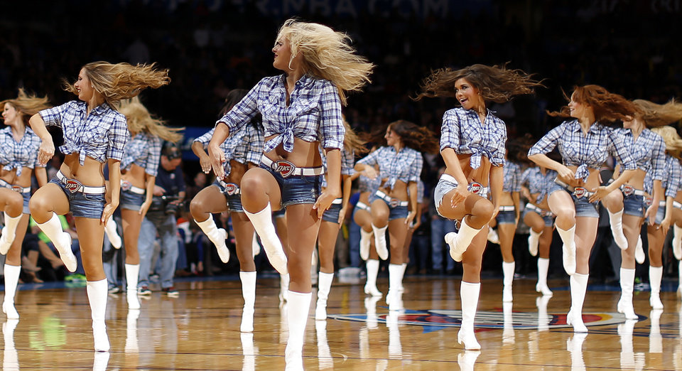 Photo - The Thunder Girls perform during an NBA basketball game between the Oklahoma City Thunder and the Golden State Warriors at Chesapeake Energy Arena in Oklahoma City, Friday, Jan. 17, 2014. Oklahoma City won 127-121. Photo by Bryan Terry, The Oklahoman