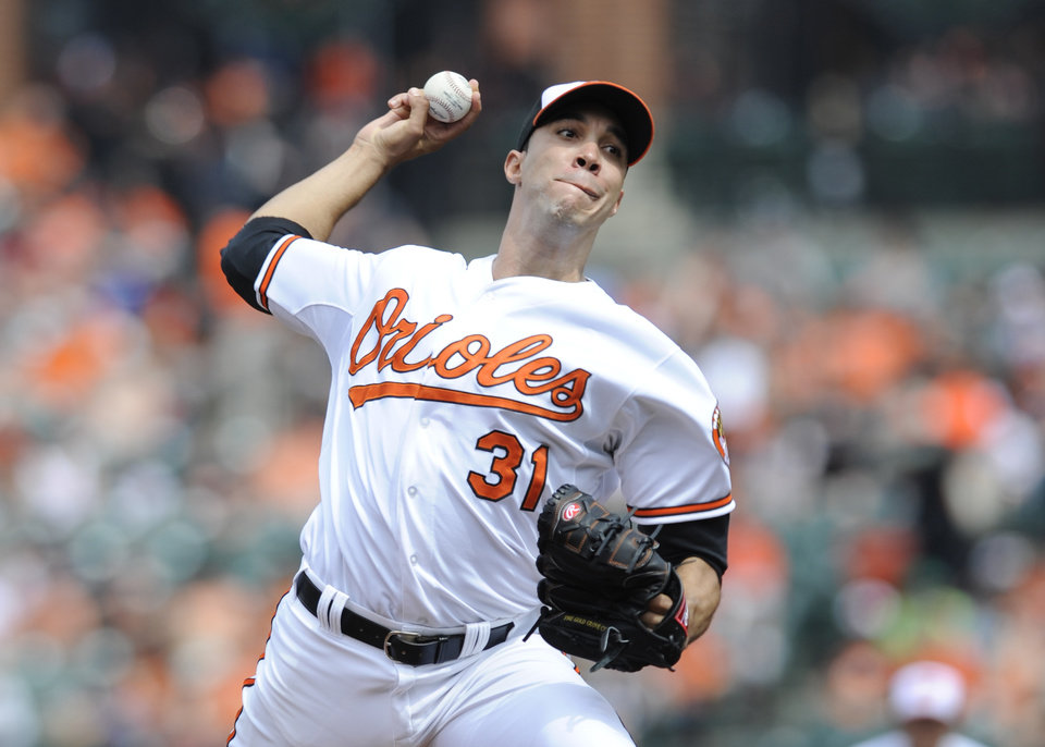 Photo - Baltimore Orioles starting pitcher Ubaldo Jimenez delivers against the Toronto Blue Jays in the first inning of a baseball game on Sunday, April 13, 2014, in Baltimore. (AP Photo/Gail Burton)