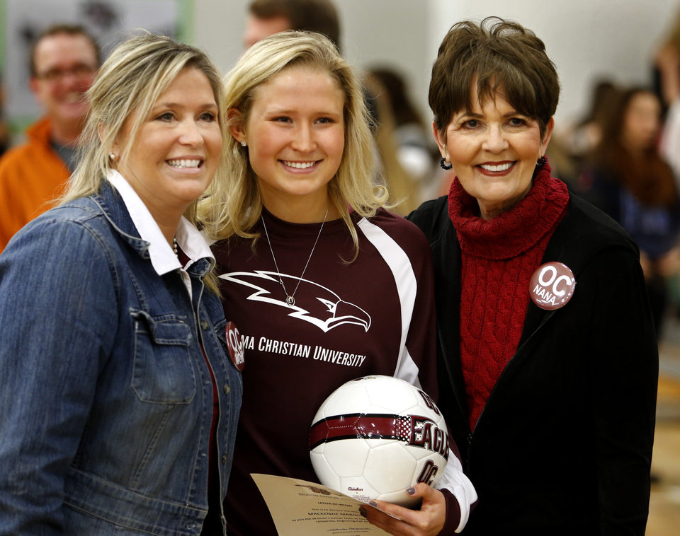 Photo - Athlete Mackenzie Marquardt poses for a photograph with her mother Angela Marquardt and grandmother Jaclynn Reynolds at signing day ceremonies at Norman North High School on Wednesday, Feb. 5, 2014 in Norman, Okla.  She will play soccer for Oklahoma Christian.  Photo by Steve Sisney, The Oklahoman