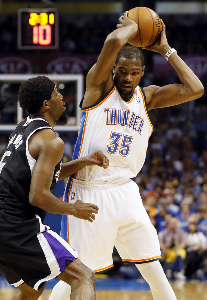 Oklahoma City's Kevin Durant (35) keeps the ball away from Sacramento's John Salmons (5) during an NBA basketball game between the Oklahoma City Thunder and the Sacramento Kings at Chesapeake Energy Arena in Oklahoma City, Monday, April 15, 2013. Photo by Nate Billings, The Oklahoman