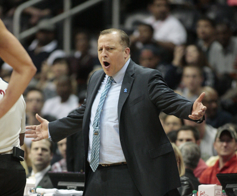 Photo - Chicago Bulls coach Tom Thibodeau reacts to a call from a referee in the first half of an NBA basketball game against the Atlanta Hawks on Wednesday, April 2, 2014, in Atlanta. (AP Photo/Jason Getz)