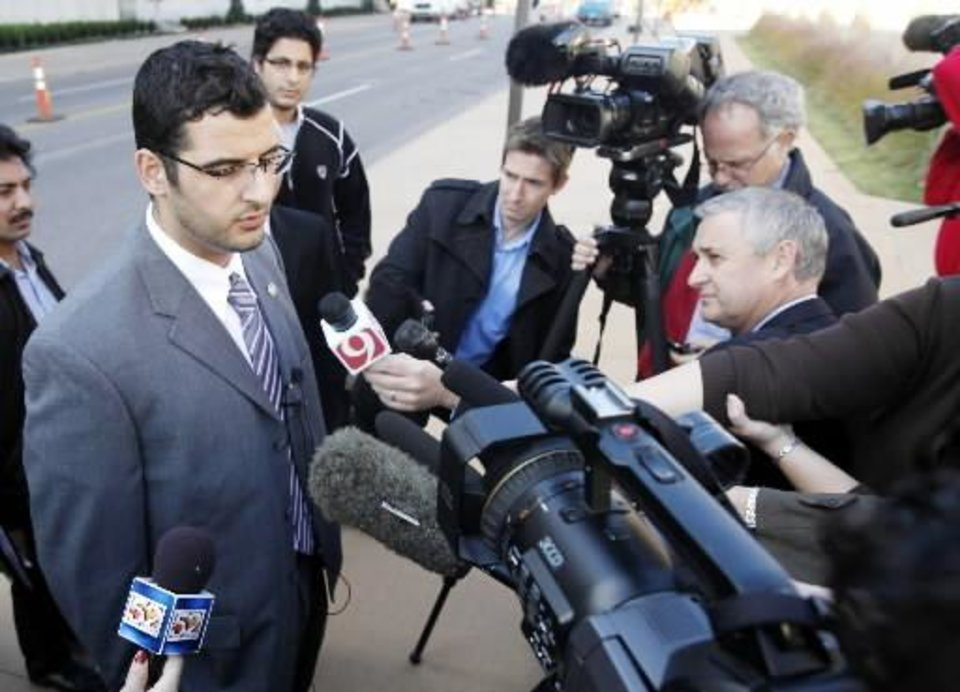 Muneer Awad, executive director of Council on American-Islamic Relations in Oklahoma, talks to members of the media outside Federal Courthouse in Oklahoma City, Monday Nov. 8 , 2010 after U.S. District Judge Vicki Miles-LaGrange issued a temporary restraining order blocking a state constitutional amendment that prohibits state courts from considering international or Islamic law when deciding cases. (AP Photo/The Oklahoman, Steve Gooch)