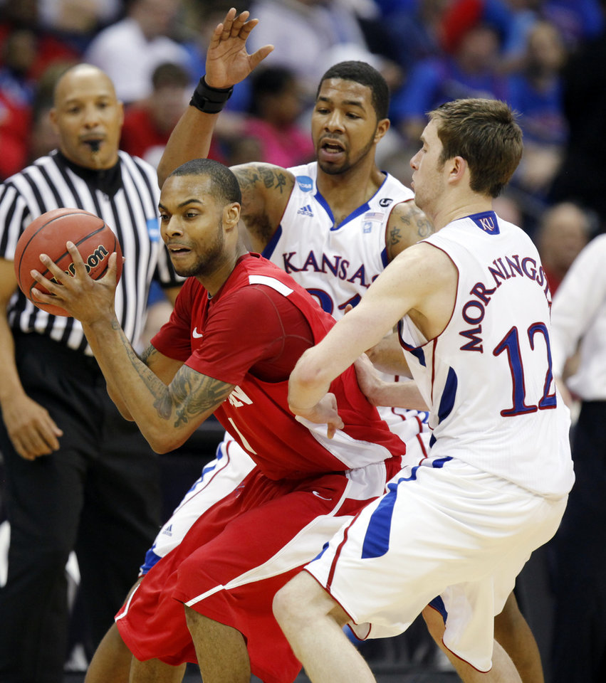 Photo - Markieff Morris (21), middle, and Brady Morningstar (12) of Kansas defend Darryl Partin (1) of Boston in the second half during the NCAA men's basketball tournament second round game between Boston and Kansas at the BOK Center in Tulsa, Okla., Friday, March 18, 2011. Kansas won, 72-53. Photo by Nate Billings, The Oklahoman