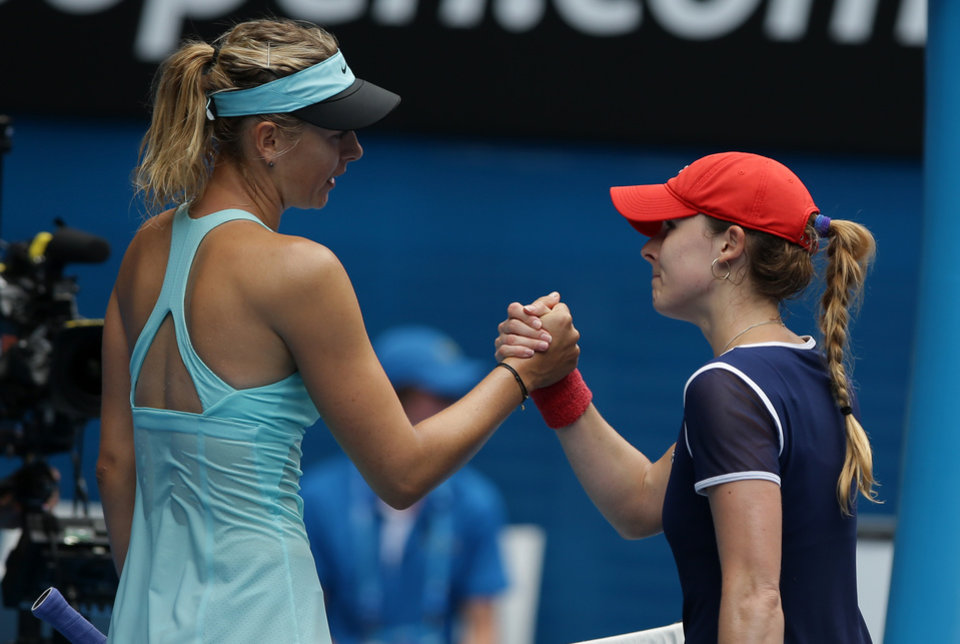 Photo - Maria Sharapova, left, of Russia is congratulated by Alize Cornet of France after winning their third round match at the Australian Open tennis championship in Melbourne, Australia, Saturday, Jan. 18, 2014.(AP Photo/Aaron Favila)