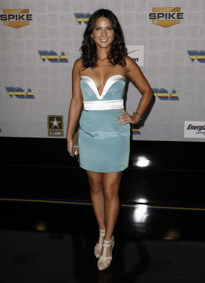 Photo -  Olivia Munn arrives at Spike TV's Video Game Awards on Saturday, Dec. 11, 2010, in Los Angeles. (AP Photo/Matt Sayles)