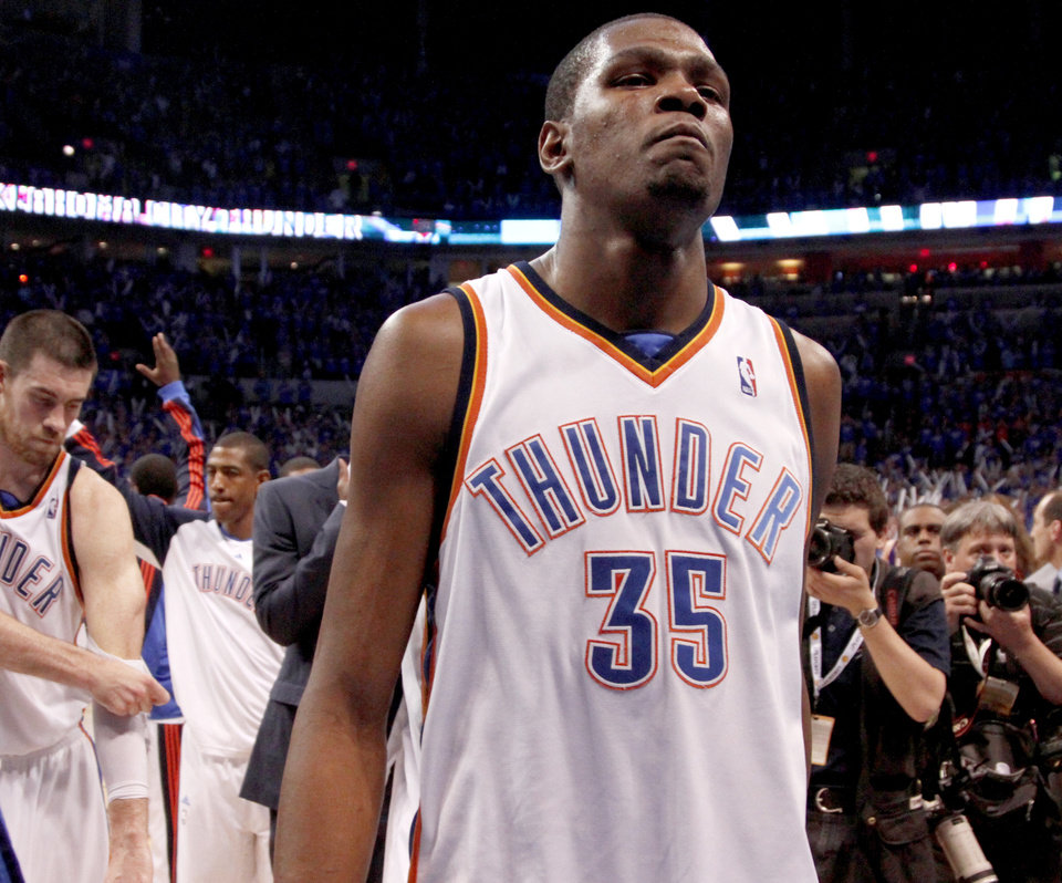 Photo - Kevin Durant walks off the court after the loss to the Lakers in April. Photo by Bryan Terry, The Oklahoman