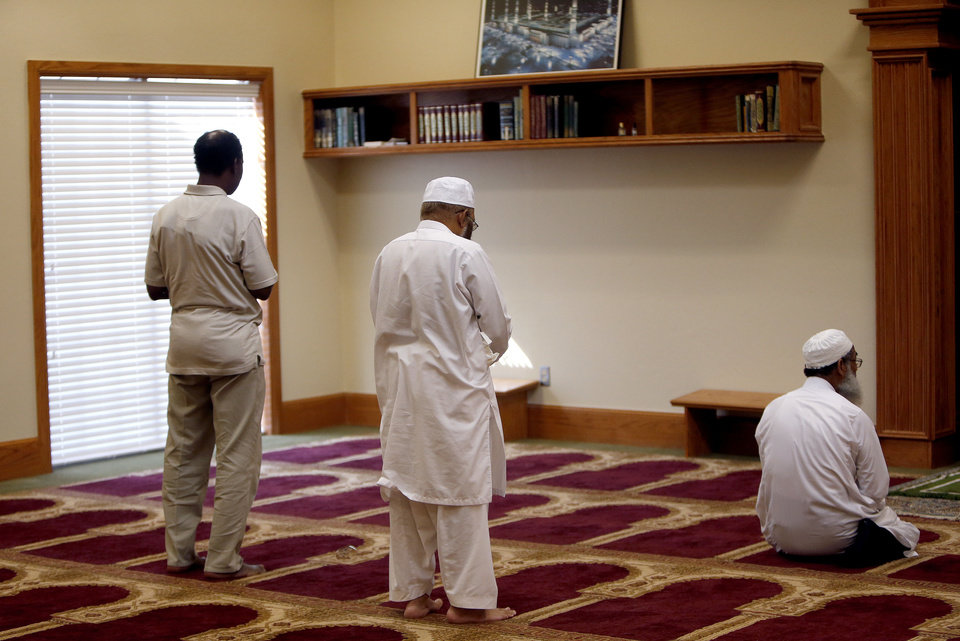 Photo - Men pray at the Islamic Society of Norman's new mosque at 420 E Lindsey in Norman.   SARAH PHIPPS - SARAH PHIPPS