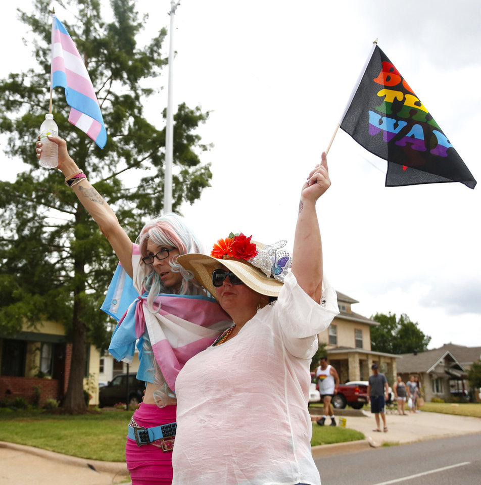 Photo - Jamie Hawly, left, and Shanon Buckingham walk in the OKC Pride Parade on NW 39 in Oklahoma City, Sunday, June 26, 2016. Photo by Kurt Steiss, The Oklahoman