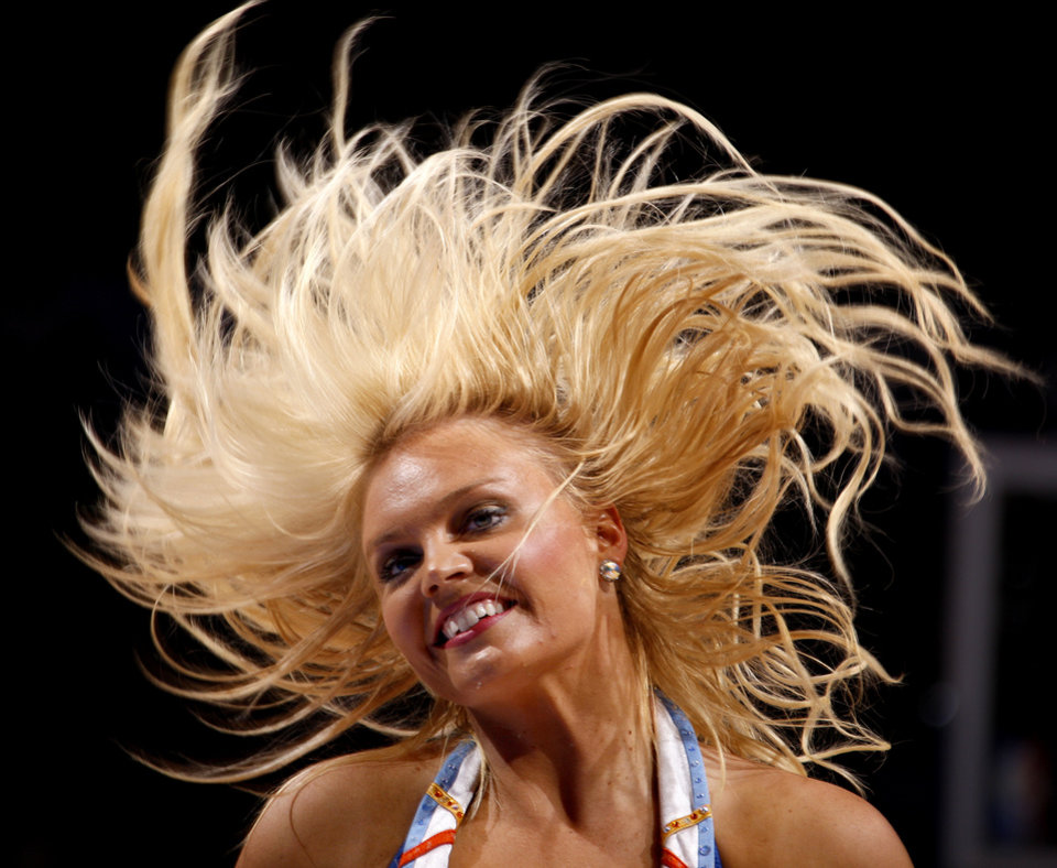 Photo - A member of the Thunder Girls performs during the NBA basketball game between the Oklahoma City Thunder and the Los Angeles Clippers at Chesapeake Energy Arena in Oklahoma City, Wednesday, April 11, 2012. Photo by Bryan Terry, The Oklahoman
