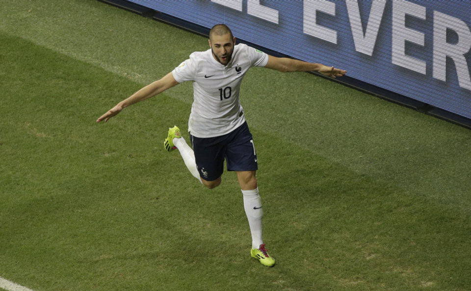 Photo - France's Karim Benzema celebrates before his goal was disallowed after Netherlands referee Bjorn Kulpers had blown his whistle for full time before the ball entered the gaol during the group E World Cup soccer match between Switzerland and France at the Arena Fonte Nova in Salvador, Brazil, Friday, June 20, 2014. (AP Photo/Sergei Grits)