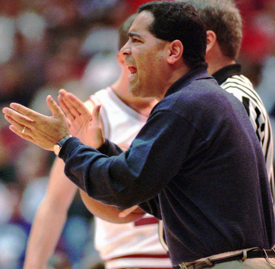 OU basketball coach Kelvin Sampson tries to encourage his team against Kansas State.