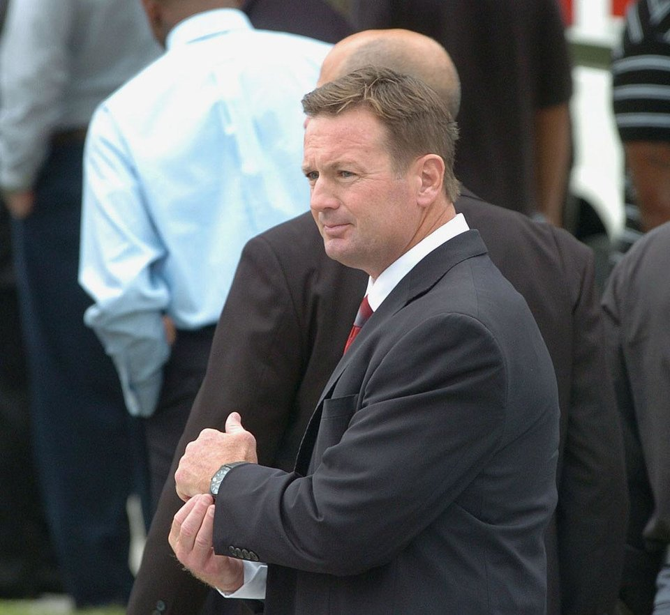 University of Oklahoma football coach Bob Stoops arrives for the memorial service held for former Tampa Bay Buccaneers football player and Hall of Famer Lee Roy Selmon at Idlewild Baptist Church in Lutz, Fla. on Friday, Sept. 9, 2011 (AP Photo/The Tampa Tribune, Andy Jones) ST. PETERSBURG OUT; LAKELAND OUT; BRADENTON OUT; MAGS OUT; LOCAL TV OUT; WTSP CH 10 OUT; WFTS CH 28 OUT; WTVT CH 13 OUT; BAYNEWS 9 OUT ORG XMIT: FLTAM201