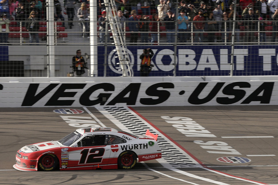 Sam Hornish Jr. crosses the finish line to win the NASCAR Nationwide Series auto race, Saturday, March 9, 2013, in Las Vegas. (AP Photo/Julie Jacobson)