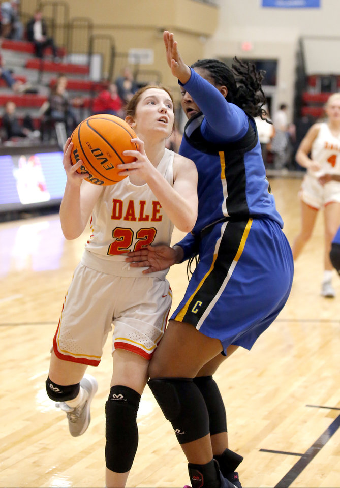 Photo - Dale's Brook Rutland goes to the basket as Madison Roberts of Classen SAS defends during a game in Dale on Jan. 14. [Sarah Phipps/The Oklahoman]
