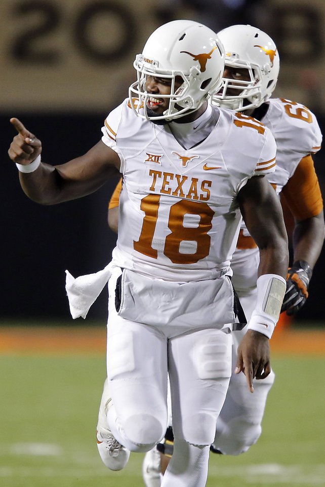 Photo - Texas' Tyrone Swoopes (18) reacts after a touchdown pass during the college football game between the Oklahoma State University Cowboys (OSU) the University of Texas Longhorns (UT) at Boone Pickens Staduim in Stillwater, Okla. on Saturday, Nov. 15, 2014.  Photo by Chris Landsberger, The Oklahoman