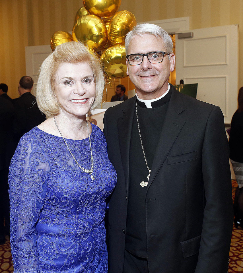 Judy Love and Archbishop Paul Coakley attended the Green Tie Gala, a benefit for Catholic Charities at the Skirvin in downtown Oklahoma City Friday, March 8, 2013. Photo by Doug Hoke, The Oklahoman
