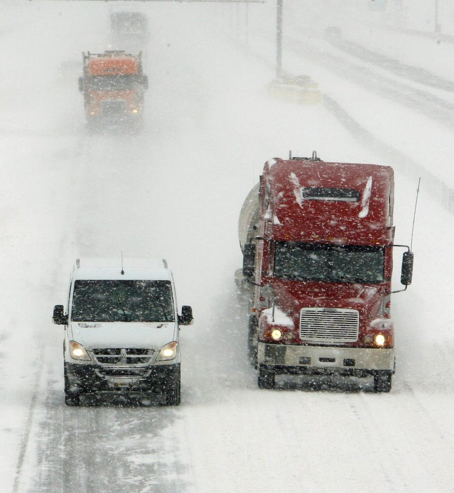 Photo - Traffic on Interstate 35 southbound at Main Street in Norman moves at 10:30 a.m. as the second round of snow in a week moved into the area on Wednesday, February 9, 2011, in Norman, Okla.   Photo by Steve Sisney, The Oklahoman