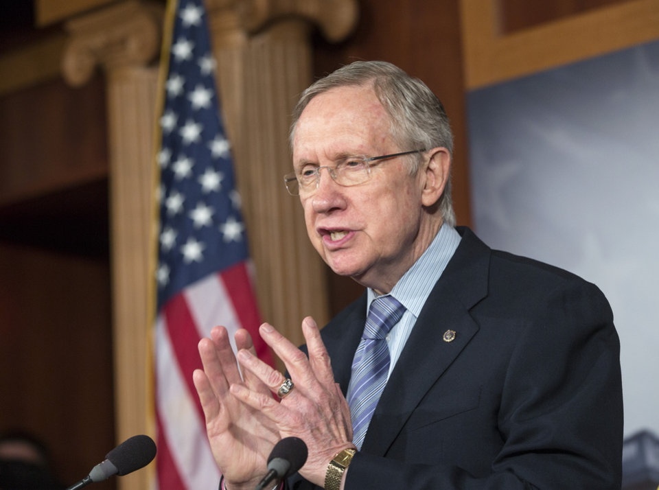 Photo - Senate Majority Leader Harry Reid, D-Nev., repeats his pledge to not touch the Affordable Care Act if House Republicans make rescinding Obamacare a part of a continuing resolution to fund the government, on Capitol Hill in Washington, Thursday, Sept. 19, 2013. (AP Photo/J. Scott Applewhite)