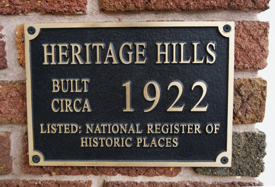 Photo - This plaque is near the front door of a home on NW 15 in Heritage Hills.  PAUL B. SOUTHERLAND - The Oklahoman Archives