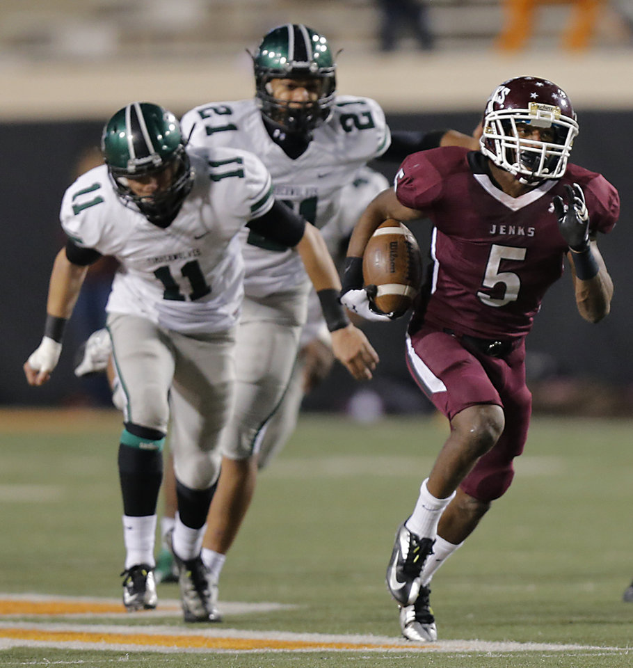 Jenks' Trey'Vonne Barr'e runs for a touchdown during the Class 6A Oklahoma state championship football game between Norman North High School and Jenks High School at Boone Pickens Stadium on Friday, Nov. 30, 2012, in Stillwater, Okla.   Photo by Chris Landsberger, The Oklahoman