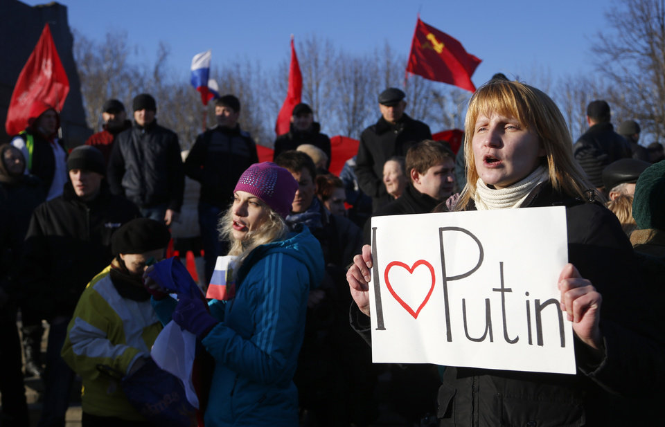 Photo - A pro Russian resident rallies with others at a central square in Donetsk, Ukraine, Friday, March 7, 2014. Russia rallied support Friday for a Crimean bid to secede from Ukraine, with Russia's top lawmaker assuring her Crimean counterpart that the region would be welcomed as