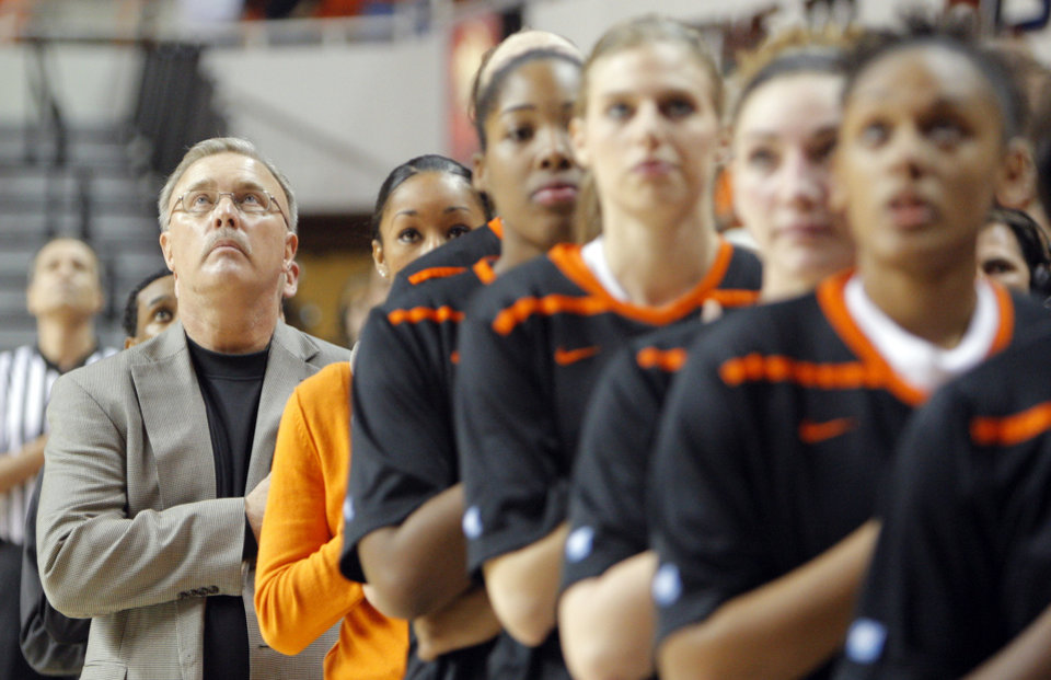 Photo - Interim head coach Jim Littell stands during National Anthem before the women's college game between Oklahoma State University and Coppin State at Gallagher-Iba Arena in Stillwater, Okla.,  Saturday, Nov. 26, 2011.  Photo by Sarah Phipps, The Oklahoman