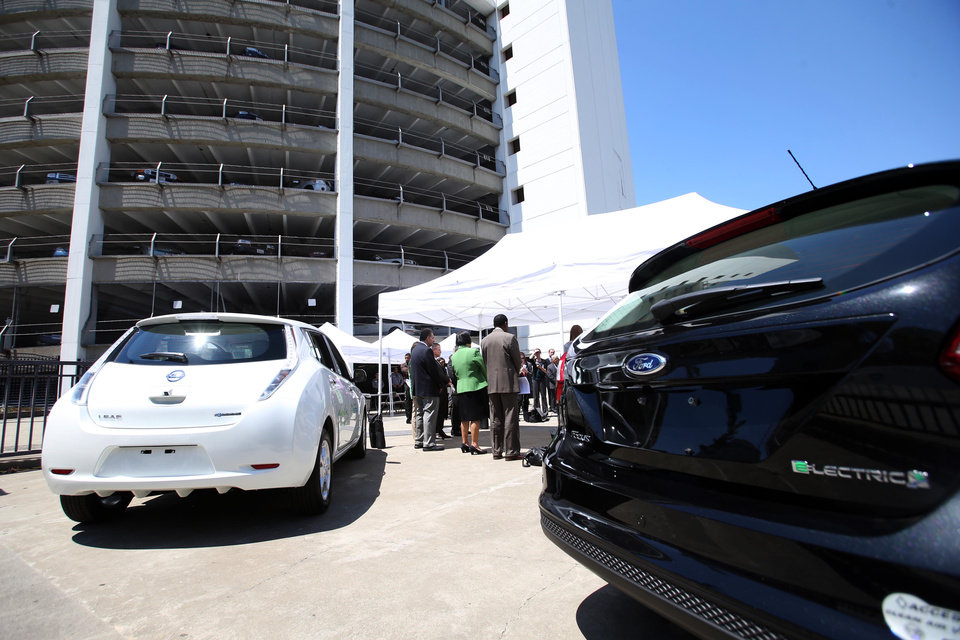 Photo - Two of the 90 electric vehicles deployed to Bay Area local governments are displayed at a press conference at the AlcoPark Garage Plaza in Oakland, Calif., Tuesday, July 8, 2014. A group of San Francisco Bay Area cities, counties and water agencies has joined forces for what is being billed as one of the largest single government purchases of all-electric vehicles in the country. (AP Photo/Bay Area News Group, Ray Chavez)
