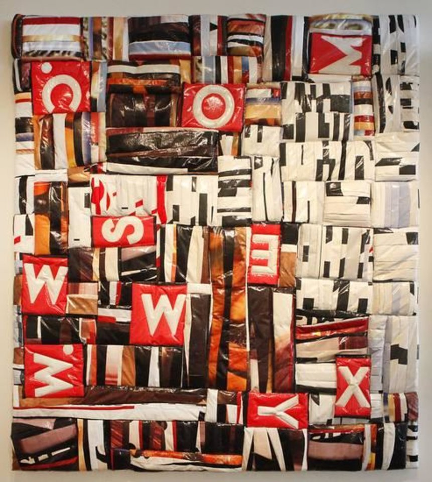 """Photo -  Dallas-based artist Jason Willaford creates abstract artwork by sewing together pieces of vinyl reclaimed from billboards. His piece """"www.sexy.com"""" is featured in his exhibit """"Vinyl Exposed"""" at Oklahoma Contemporary Arts Center. Photo by David McDaniel, The Oklahoman"""