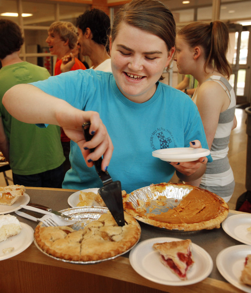 """""""Who says Math can't be fun--or delicious for that matter"""" as Frieda Rule, junior, dishes out pie as Norman High School math students sell pies and participate in other """"pi-related"""" activities for Pi Day on Wednesday, March 14, 2012, in Norman, Okla.   Photo by Steve Sisney, The Oklahoman"""