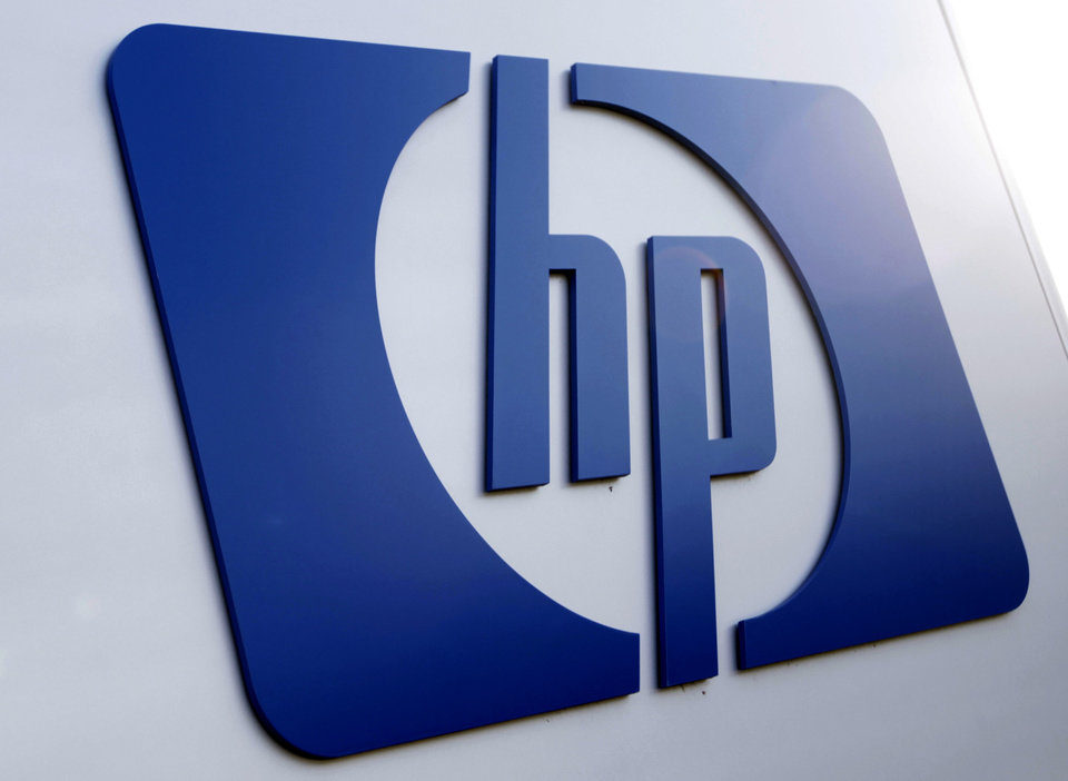 FILE - This Feb. 21, 2012 file photo shows a Hewlett Packard logo in Frisco, Texas. Hewlett-Packard said Wednesday, May 23, 2012 that it\'s laying off 27,000 workers, 8 percent of its work force, as it restructures the business. The Palo Alto, Calif., company said it\'ll save $3 billion to $3.5 billion annually from cost cuts, including the layoffs. Hewlett-Packard Co. expects to complete the job cuts by the end of fiscal 2014. (AP Photo/LM Otero, File)