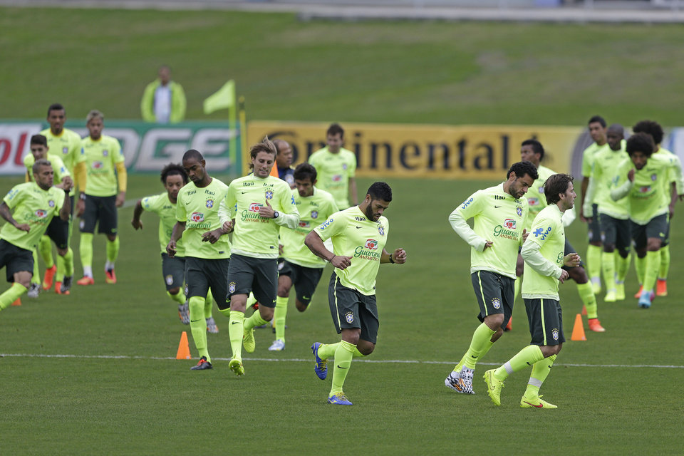 Photo - Brazilian players exercise during a training session at the Granja Comary training center in Teresopolis, Brazil, Friday, June 20, 2014. Brazil plays in group A of the 2014 soccer World Cup. (AP Photo/Andre Penner)
