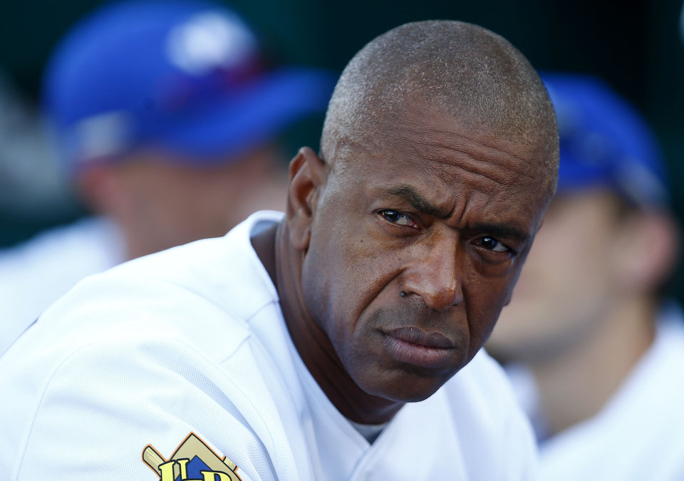 Photo - Julio Franco watches from the Fort Worth Cats dugout during a United League baseball game against the Rio Grande Valley WhiteWings in Fort Worth, Texas, Tuesday, May, 20, 2014. Franco played parts of 23 major league seasons for eight teams from 1982-2007, with stints in Japan, Mexico and South Korea during that time. He was a three-time All-Star and won the 1991 American League batting title while with the Texas Rangers from 1989-93. He was the oldest active player in the majors when he played his last game for Atlanta in 2007. (AP Photo/Fort Worth Star-Telegram, Ron Jenkins) MAGS OUT (FORT WORTH WEEKLY, 360 WEST); INTERNET OUT